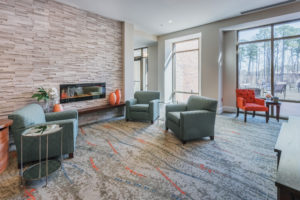 Cardinal at North Hills Piano Lobby View with Fireplace Right