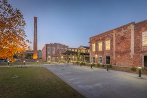 Optimist Hall Duke Energy Charlotte NC Exterior Twilight Back with Stack